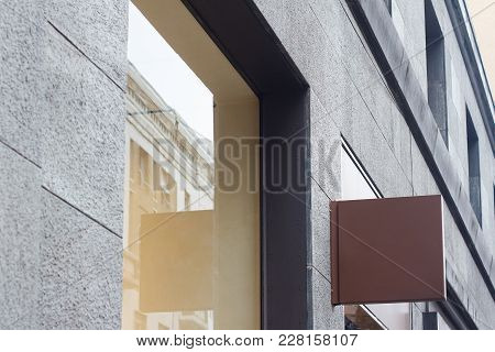 Horizontal Side View Of Empty Blank Signage Of Store Clothes Shop On Business Skyscraper With Modern