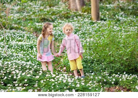 Children In Spring Park With Flowers