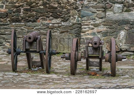 Old Brass Cannons In The Courtyard Of The Ruins Of The Medieval Bolkow Castle In Lower Silesia, Pola