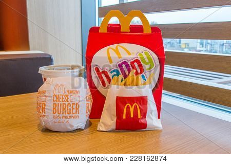 Gdansk, Poland - February 21, 2018: Mcdonalds Happy Meal Box With Coca-cola, French Fries And Cheese