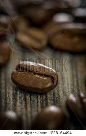 Macro Shot Of A Steaming Coffee Bean