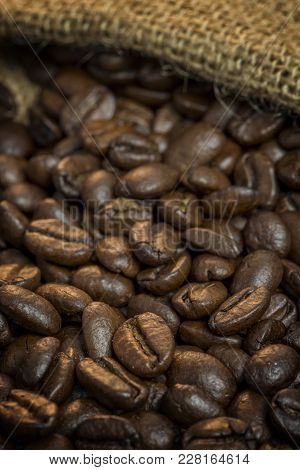 Close Up Of Coffee Beans Out Of A Jute Bag