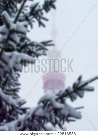 Kiev Tv Tower In The Snowy Haze. Blurred Background