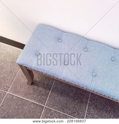 Detail Of Interior With Classic Style Grey Bench On Ceramic Tile Floor.