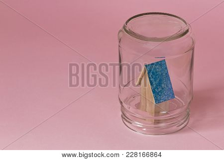 House In A Jar Protected In Safety. Protected From Misfortunes. House In A Jar On A Pink Background