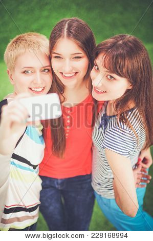 Portrait Of Three Young Women, Standing Together.
