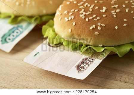Burgers With One Hundred And One Thousand Russian Rubles Bills. Business Concept