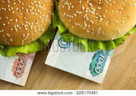 Burgers With One Thousand And Five Thousand Russian Rubles Bills. Business Concept