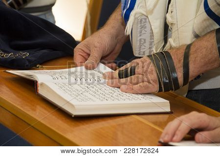 Rehovot, Israel - January 19, 2018: An Adult Man Pointing At A Phrase In A Bible Book (sefer Torah),