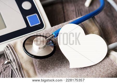 Sphygmomanometer And Stethoscope Kit Used To Measure Blood Pressure, Paper Heart