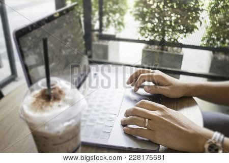 Woman Hand On Laptop Keyboard With Morning Coffee, Stock Photo