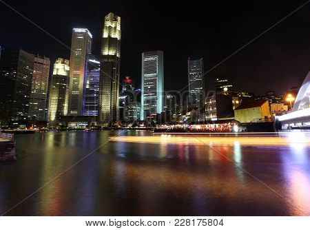 Nightime In Singapore At South Bridge Road Showing Illuminated Buildings And Light Trail From Touris