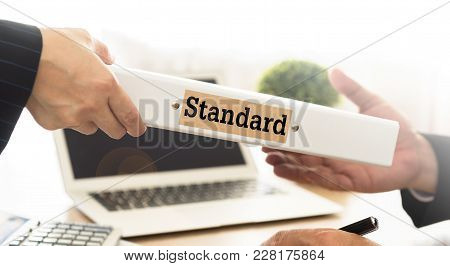 Standard Concept. Staff Sends Report Of The Result Of The Measurement Standard Production To Manager