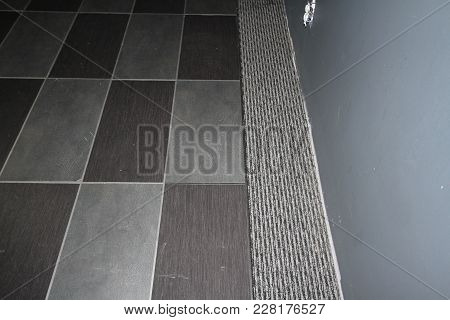 Strips Of Carpet Tiles Embedded Into A Carpet