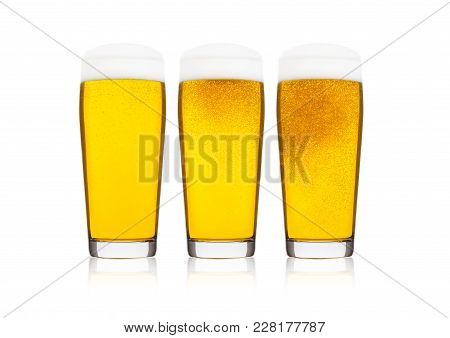 Cold elegant glasses of lager beer with foam and dew isolated on white background poster