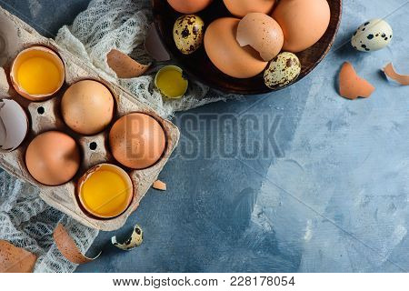 Raw Eggs Cooking Background. Quail And Brown Chicken Eggs In Wooden Dishes And Carton Tray. Modern E