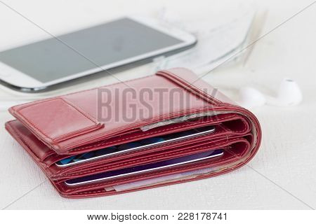 Red Purse With Slips Credit Card Check Expense And Mobile Phone On Table White