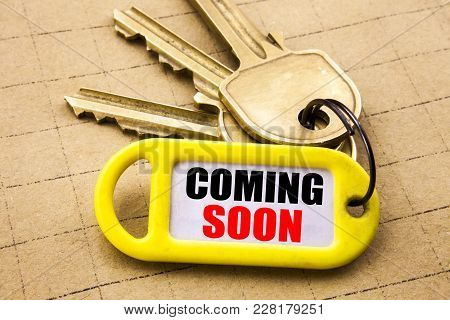 Word, Writing Coming Soon. Business Concept For Under Construction Written On Key Holder, Close Up.