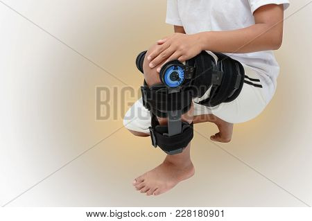 Woman's Leg In Knee Brace For Stabilization And Support