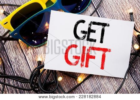 Writing Text Showing Get Gift. Business Concept For Free Shoping Coupon Written On Old Wood Wooden B