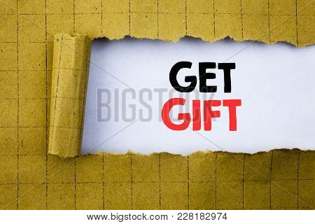 Get Gift. Business Concept For Free Shoping Coupon Written On White Paper On Yellow Folded Paper.