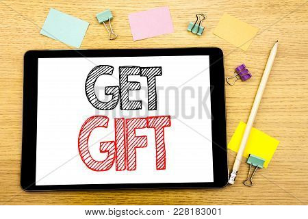 Writing Text Showing Get Gift. Business Concept For Free Shoping Coupon Written On Tablet, Wooden Ba