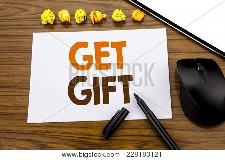 Conceptual Hand Writing Text Showing Get Gift. Business Concept For Free Shoping Coupon Written On S
