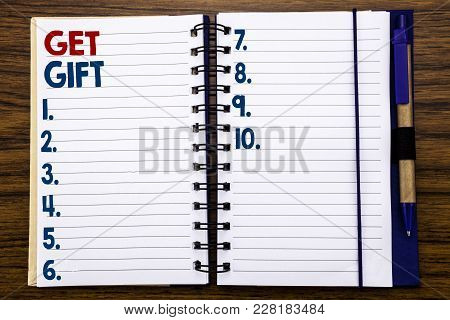 Writing Text Showing Get Gift. Business Concept For Free Shoping Coupon Written On Notebook Paper, W