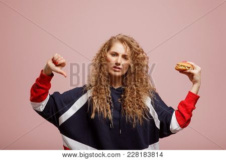 Beautiful Girl With Curly Hair Shows Aversion To Harmful And Fatty Food Of Burger, Dislike Hand, Thu