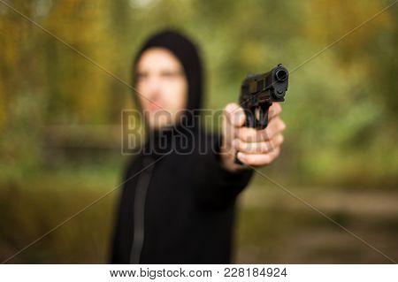 A Man Holding A Gun In Hand, The Ship Ready To Shoot The Man Pointed A Gun At Us. A Man Holding A Gu