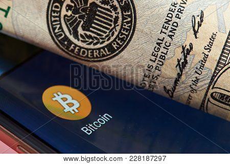 New York, Usa - June 26, 2017: Bitcoin Against Dollar System. Bitcoin Smartphone Application Close-u