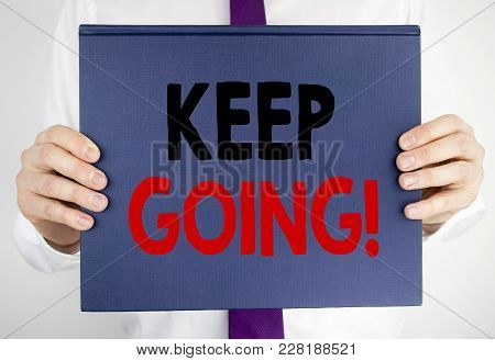 Writing Text Showing Keep Going. Business Concept For Go Moving Forward Letting Written On Book Note