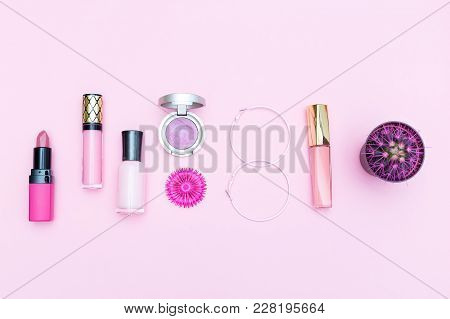 Pink Cosmetics On A Pink Background And A Pink Cactus. Flat Lay