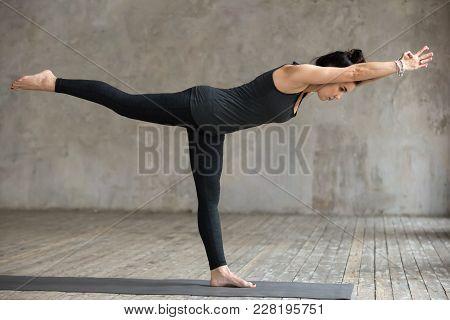 Young Woman Practicing Yoga, Doing Virabhadrasana 3 Exercise, Warrior Iii Pose, Working Out, Wearing