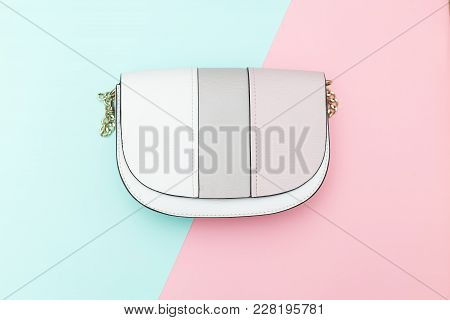 Women's Handbag On Two Pastel Color Background. Flat Lay
