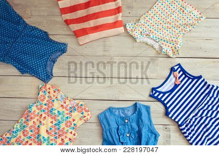 Beautiful Kidswear On A White Wooden Background