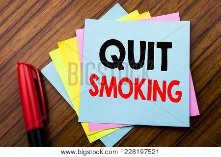 Handwriting Announcement Text Quit Smoking.  Concept For Stop For Cigarette  Written On Sticky Stick