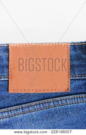 Denim Blue Jeans Empty Leather Label On Back Side. Pair Of Classic Modern Style Clothing Blue Jeans.
