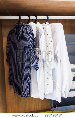 Shirts Hanging In Wooden Closet, Man Cloth Ordinary Kept