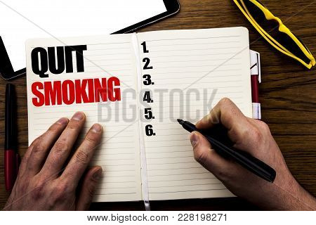 Word, Writing Quit Smoking. Business Concept For Stop For Cigarette  Written Book, Wooden Background