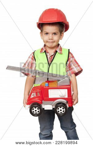 Child In A Red Helmet And With A Fire Engine In His Hands