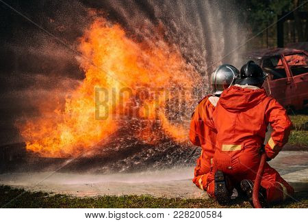 Firefighters Water Spray By High Pressure Nozzle In Fire, Fire And Rescue