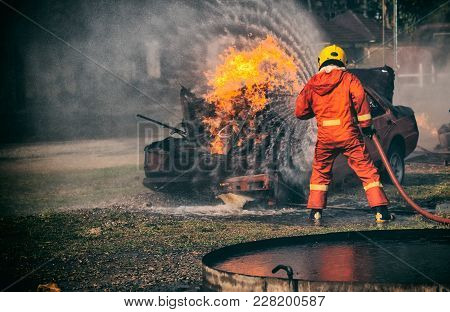 Firefighters Fighting A Fire,firefighter Training With Gas And Flame