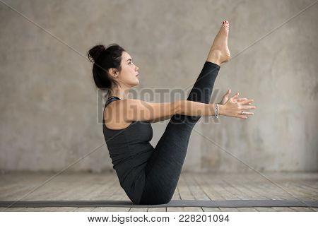 Young Yogi Woman Practicing Yoga, Doing Paripurna Navasana Exercise, Boat Pose, Working Out, Wearing