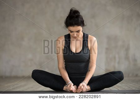 Young Sporty Woman Practicing Yoga, Doing Butterfly Exercise, Baddha Konasana Pose, Working Out, Wea