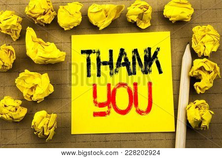 Thank You. Business Concept For Gratitude Thanks Written On Sticky Note Paper On Vintage Background.