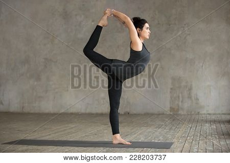 Young Sporty Woman Practicing Yoga, Doing Natarajasana Exercise, Lord Of The Dance Pose, Working Out