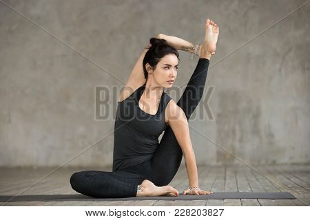 Young Sporty Woman Practicing Yoga, Doing Surya Yantrasana Exercise, Compass Pose, Working Out, Wear