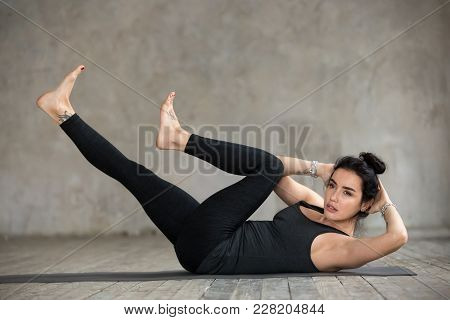 Young Sporty Woman Practicing Fitness, Doing Crisscross Exercise, Bicycle Crunches Pose, Working Out