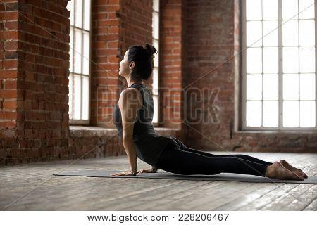 Young Sporty Woman Practicing Yoga, Doing Upward Facing Dog Exercise, Urdhva Mukha Shvanasana Pose,
